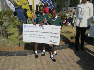 Proudly holding up a cheque sponcered by Department of water and Sanitation for their work with mini SASS