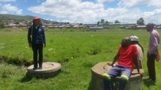 Nohlanipho Zondo proudly shows us the once flowing manhole